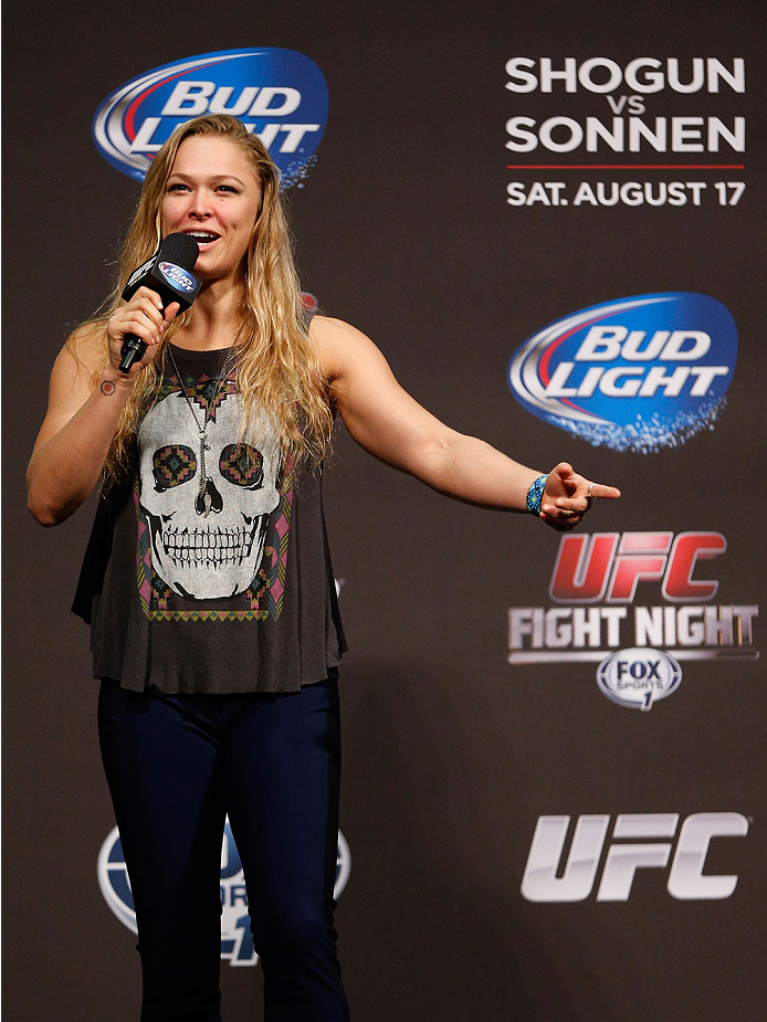 BOSTON, MA - AUGUST 16:  UFC women's bantamweight champion Ronda Rousey interacts with fans during a Q&A session befofe the UFC weigh-in inside TD Garden on August 16, 2013 in Boston, Massachusetts. (Photo by Josh Hedges/Zuffa LLC/Zuffa LLC via Getty Imag