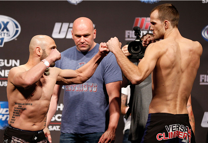 BOSTON, MA - AUGUST 16:  (L-R) Opponents Manny Gamburyan and Cole Miller face off during the UFC weigh-in inside TD Garden on August 16, 2013 in Boston, Massachusetts. (Photo by Josh Hedges/Zuffa LLC/Zuffa LLC via Getty Images)