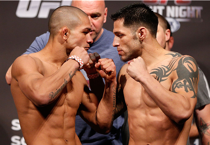 BOSTON, MA - AUGUST 16:  (L-R) Opponents Diego Brandao and Daniel Pineda face off during the UFC weigh-in inside TD Garden on August 16, 2013 in Boston, Massachusetts. (Photo by Josh Hedges/Zuffa LLC/Zuffa LLC via Getty Images)