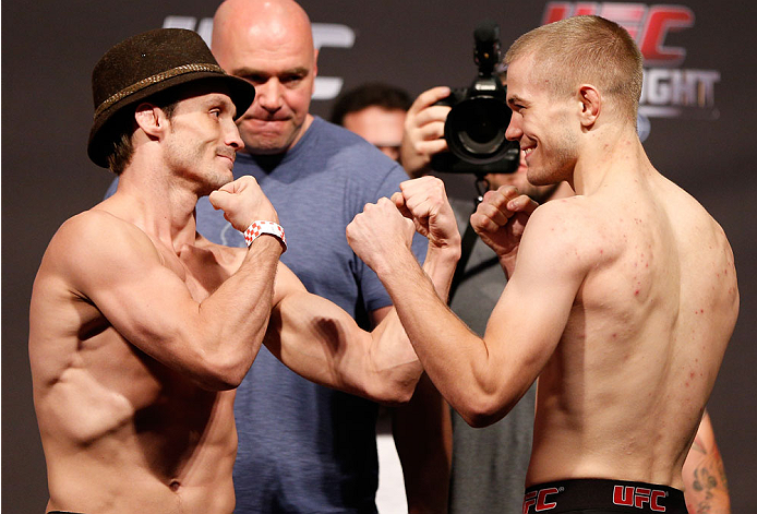 BOSTON, MA - AUGUST 16:  (L-R) Opponents Brad Pickett and Michael McDonald face off during the UFC weigh-in inside TD Garden on August 16, 2013 in Boston, Massachusetts. (Photo by Josh Hedges/Zuffa LLC/Zuffa LLC via Getty Images)