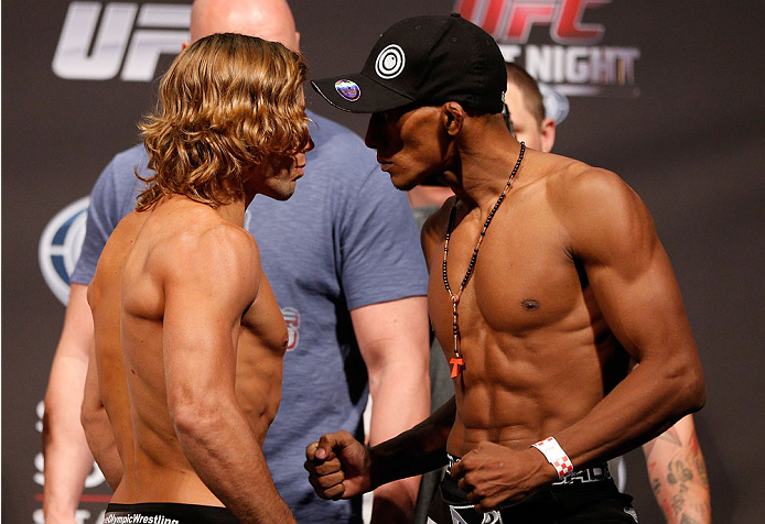 BOSTON, MA - AUGUST 16:  (L-R) Opponents Urijah Faber and Iuri Alcantara face off during the UFC weigh-in inside TD Garden on August 16, 2013 in Boston, Massachusetts. (Photo by Josh Hedges/Zuffa LLC/Zuffa LLC via Getty Images)