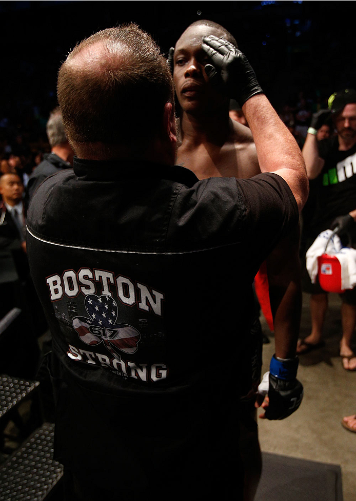 """BOSTON, MA - AUGUST 17:  A UFC cutman displays a """"Boston Strong"""" logo on his vest as Ovince Saint Preux prepares to enter the Octagon before his UFC light heavyweight bout against Cody Donovan at TD Garden on August 17, 2013 in Boston, Massachusetts. (Pho"""