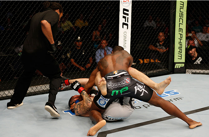 BOSTON, MA - AUGUST 17:  (R-L) Ovince Saint Preux punches Cody Donovan as referee Herb Dean moves in to stop the bout in their UFC light heavyweight bout at TD Garden on August 17, 2013 in Boston, Massachusetts. (Photo by Josh Hedges/Zuffa LLC/Zuffa LLC v