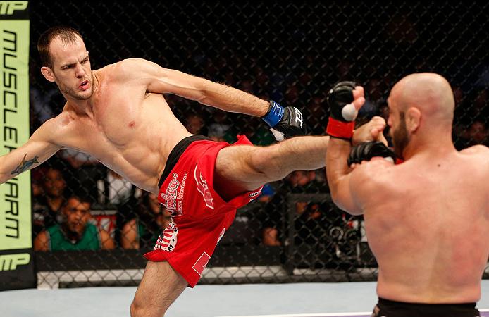 BOSTON, MA - AUGUST 17:  (L-R) Cole Miller kicks Manny Gamburyan in their UFC featherweight bout at TD Garden on August 17, 2013 in Boston, Massachusetts. (Photo by Josh Hedges/Zuffa LLC/Zuffa LLC via Getty Images)