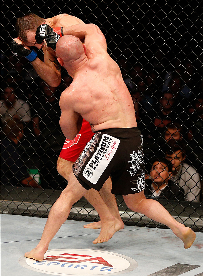 BOSTON, MA - AUGUST 17:  (R-L) Manny Gamburyan punches Cole Miller in their UFC featherweight bout at TD Garden on August 17, 2013 in Boston, Massachusetts. (Photo by Josh Hedges/Zuffa LLC/Zuffa LLC via Getty Images)