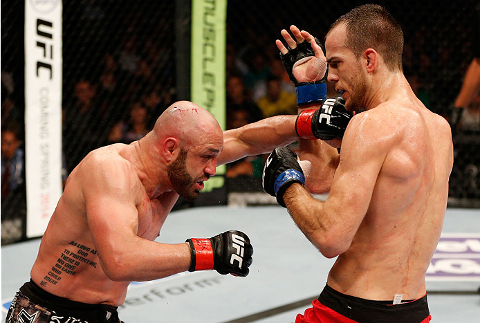 BOSTON, MA - AUGUST 17:  (L-R) Manny Gamburyan punches Cole Miller in their UFC featherweight bout at TD Garden on August 17, 2013 in Boston, Massachusetts. (Photo by Josh Hedges/Zuffa LLC/Zuffa LLC via Getty Images)
