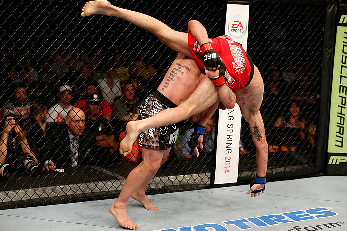 BOSTON, MA - AUGUST 17:  (L-R) Manny Gamburyan takes down Cole Miller in their UFC featherweight bout at TD Garden on August 17, 2013 in Boston, Massachusetts. (Photo by Josh Hedges/Zuffa LLC/Zuffa LLC via Getty Images)