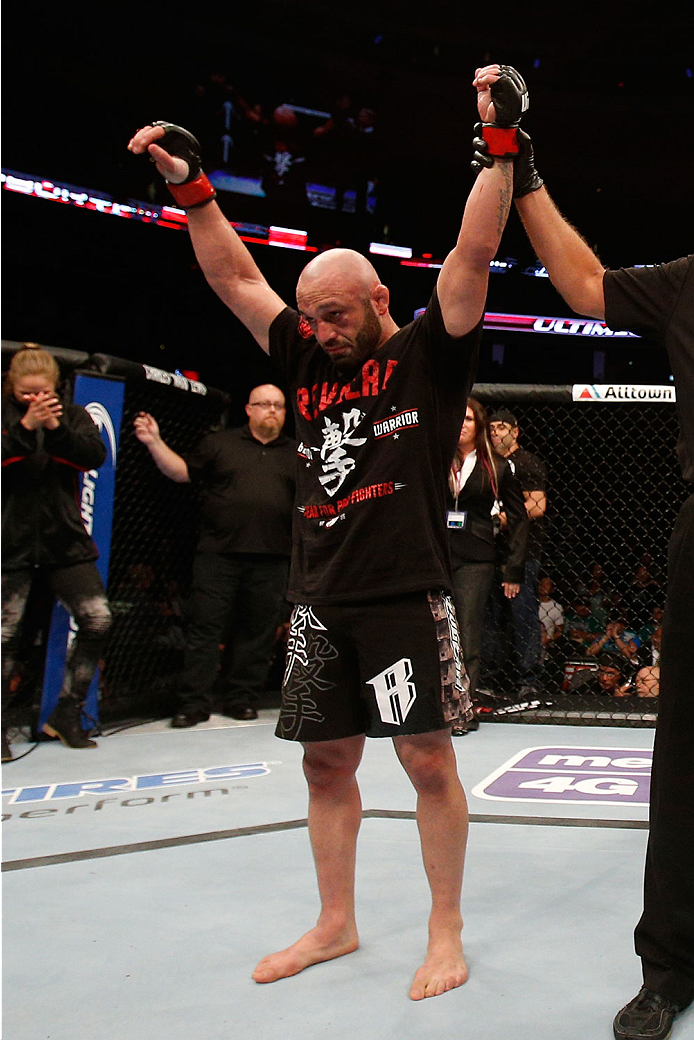 BOSTON, MA - AUGUST 17:  Manny Gamburyan reacts after his decision victory over Cole Miller in their UFC featherweight bout at TD Garden on August 17, 2013 in Boston, Massachusetts. (Photo by Josh Hedges/Zuffa LLC/Zuffa LLC via Getty Images)