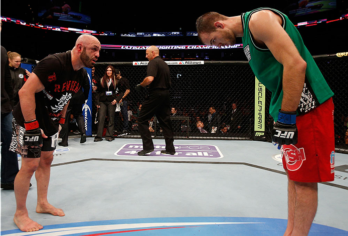 BOSTON, MA - AUGUST 17:  (L-R) Manny Gamburyan and Cole Miller bow to each ofter after their UFC featherweight bout at TD Garden on August 17, 2013 in Boston, Massachusetts. (Photo by Josh Hedges/Zuffa LLC/Zuffa LLC via Getty Images)