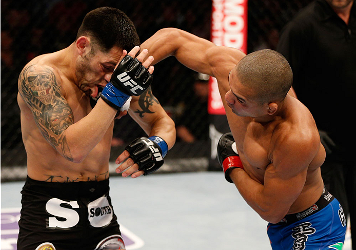 BOSTON, MA - AUGUST 17:  (R-L) Diego Brandao punches Daniel Pineda in their UFC featherweight bout at TD Garden on August 17, 2013 in Boston, Massachusetts. (Photo by Josh Hedges/Zuffa LLC/Zuffa LLC via Getty Images)