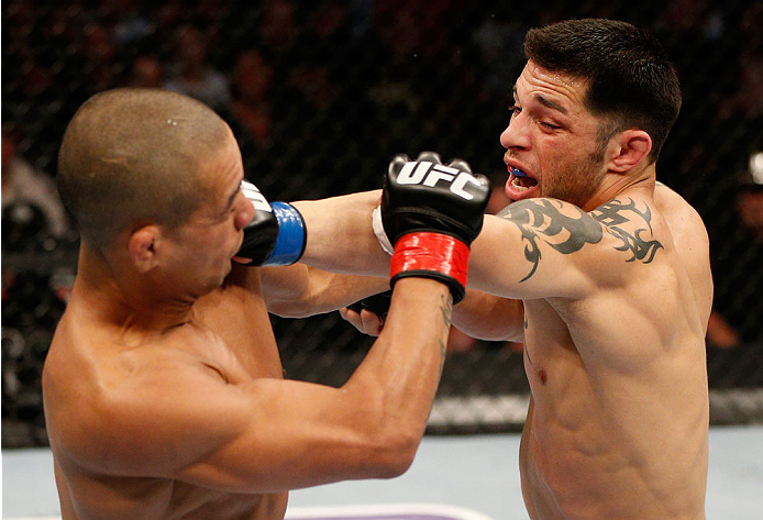 BOSTON, MA - AUGUST 17:  (R-L) Daniel Pineda punches Diego Brandao in their UFC featherweight bout at TD Garden on August 17, 2013 in Boston, Massachusetts. (Photo by Josh Hedges/Zuffa LLC/Zuffa LLC via Getty Images)