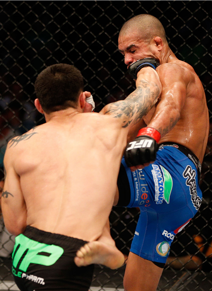 BOSTON, MA - AUGUST 17:  (L-R) Daniel Pineda punches Diego Brandao in their UFC featherweight bout at TD Garden on August 17, 2013 in Boston, Massachusetts. (Photo by Josh Hedges/Zuffa LLC/Zuffa LLC via Getty Images)