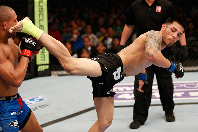 BOSTON, MA - AUGUST 17:  (R-L) Daniel Pineda kicks Diego Brandao in their UFC featherweight bout at TD Garden on August 17, 2013 in Boston, Massachusetts. (Photo by Josh Hedges/Zuffa LLC/Zuffa LLC via Getty Images)