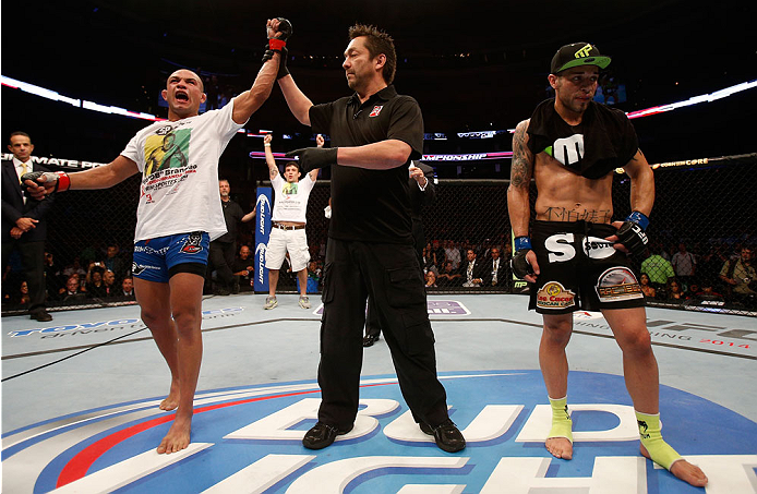 BOSTON, MA - AUGUST 17:  Diego Brandao (L) reacts after his decision victory over Daniel Pineda in their UFC featherweight bout at TD Garden on August 17, 2013 in Boston, Massachusetts. (Photo by Josh Hedges/Zuffa LLC/Zuffa LLC via Getty Images)