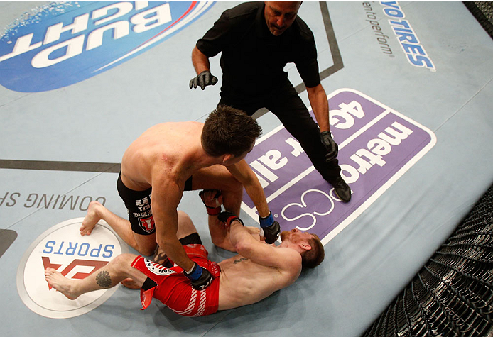 BOSTON, MA - AUGUST 17:  (L-R) Steven Siler knocks out Mike Brown with a series of punches on the ground in their UFC featherweight bout at TD Garden on August 17, 2013 in Boston, Massachusetts. (Photo by Josh Hedges/Zuffa LLC/Zuffa LLC via Getty Images)