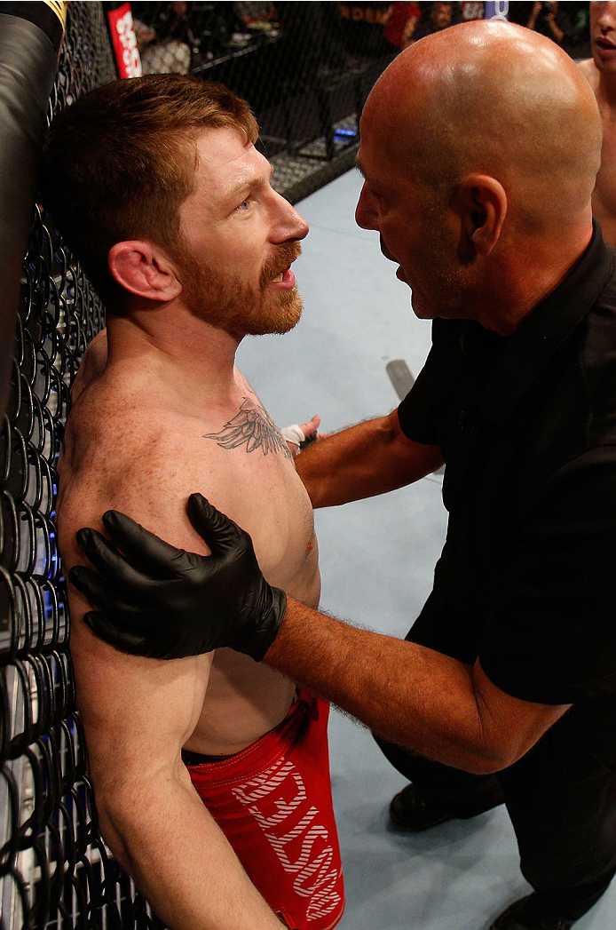 BOSTON, MA - AUGUST 17:  (L-R) Mike Brown protests to referee Yves Lavigne after his knockout loss to Steven Siler in their UFC featherweight bout at TD Garden on August 17, 2013 in Boston, Massachusetts. (Photo by Josh Hedges/Zuffa LLC/Zuffa LLC via Gett