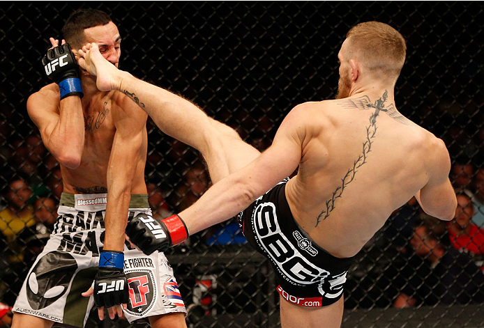 BOSTON, MA - AUGUST 17:  (R-L) Conor McGregor kicks Max Holloway in their UFC featherweight bout at TD Garden on August 17, 2013 in Boston, Massachusetts. (Photo by Josh Hedges/Zuffa LLC/Zuffa LLC via Getty Images)