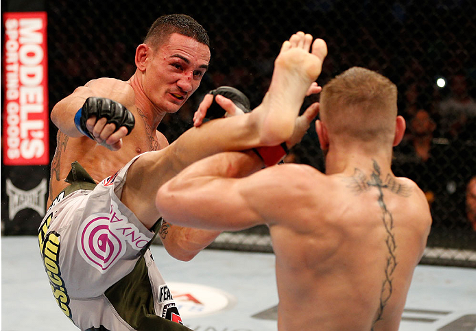 BOSTON, MA - AUGUST 17:  (L-R) Max Holloway kicks Conor McGregor in their UFC featherweight bout at TD Garden on August 17, 2013 in Boston, Massachusetts. (Photo by Josh Hedges/Zuffa LLC/Zuffa LLC via Getty Images)