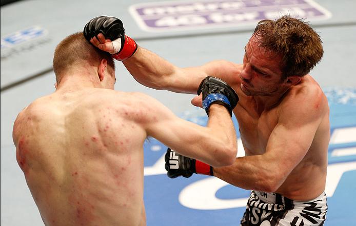 BOSTON, MA - AUGUST 17:  (L-R) Michael McDonald punches Brad Pickett in their UFC bantamweight bout at TD Garden on August 17, 2013 in Boston, Massachusetts. (Photo by Josh Hedges/Zuffa LLC/Zuffa LLC via Getty Images)