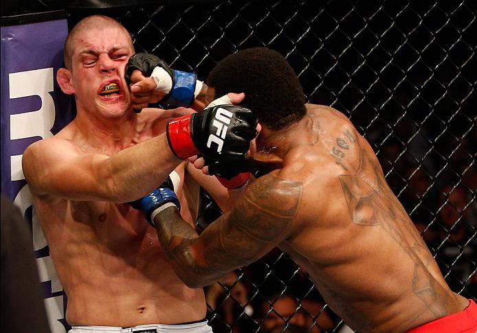 BOSTON, MA - AUGUST 17:  (R-L) Michael Johnson punches Joe Lauzon in their UFC lightweight bout at TD Garden on August 17, 2013 in Boston, Massachusetts. (Photo by Josh Hedges/Zuffa LLC/Zuffa LLC via Getty Images)