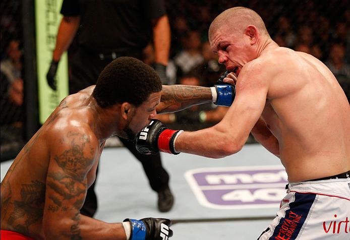 BOSTON, MA - AUGUST 17:  (L-R) Michael Johnson punches Joe Lauzon in their UFC lightweight bout at TD Garden on August 17, 2013 in Boston, Massachusetts. (Photo by Josh Hedges/Zuffa LLC/Zuffa LLC via Getty Images)
