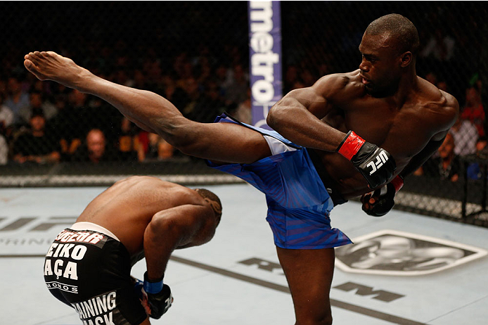 BOSTON, MA - AUGUST 17:  (R-L) Uriah Hall misses with a spinning kick against John Howard in their UFC middleweight bout at TD Garden on August 17, 2013 in Boston, Massachusetts. (Photo by Josh Hedges/Zuffa LLC/Zuffa LLC via Getty Images)