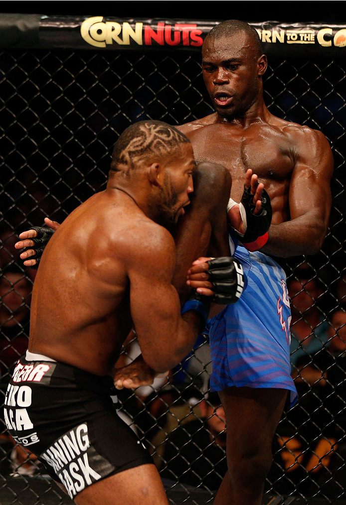 BOSTON, MA - AUGUST 17:  (R-L) Uriah Hall knees John Howard in their UFC middleweight bout at TD Garden on August 17, 2013 in Boston, Massachusetts. (Photo by Josh Hedges/Zuffa LLC/Zuffa LLC via Getty Images)