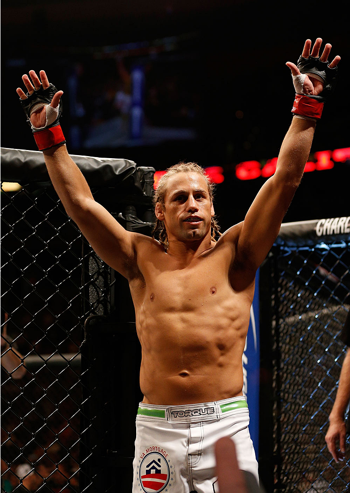 BOSTON, MA - AUGUST 17:  Urijah Faber enters the Octagon before his UFC bantamweight bout against Iuri Alcantara at TD Garden on August 17, 2013 in Boston, Massachusetts. (Photo by Josh Hedges/Zuffa LLC/Zuffa LLC via Getty Images)