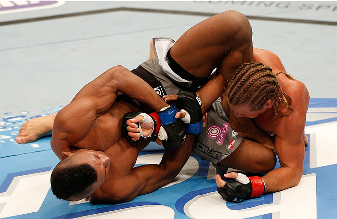 BOSTON, MA - AUGUST 17:  (L-R) Iuri Alcantara attempts an arm bar submission against Urijah Faber in their UFC bantamweight bout at TD Garden on August 17, 2013 in Boston, Massachusetts. (Photo by Josh Hedges/Zuffa LLC/Zuffa LLC via Getty Images)