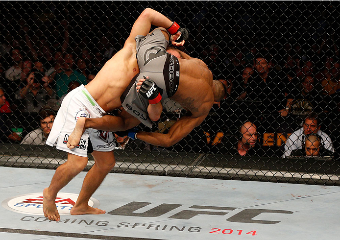 BOSTON, MA - AUGUST 17:  (L-R) Urijah Faber takes down Iuri Alcantara in their UFC bantamweight bout at TD Garden on August 17, 2013 in Boston, Massachusetts. (Photo by Josh Hedges/Zuffa LLC/Zuffa LLC via Getty Images)