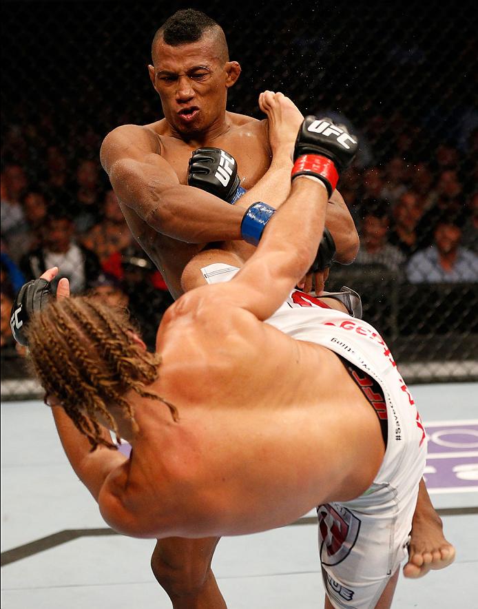 BOSTON, MA - AUGUST 17:  (L-R) Urijah Faber kicks Iuri Alcantara in their UFC bantamweight bout at TD Garden on August 17, 2013 in Boston, Massachusetts. (Photo by Josh Hedges/Zuffa LLC/Zuffa LLC via Getty Images)