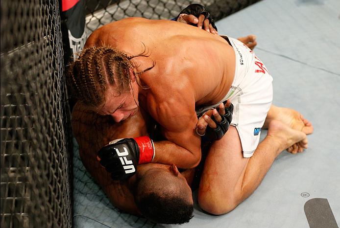BOSTON, MA - AUGUST 17:  Urijah Faber (top) elbows Iuri Alcantara in their UFC bantamweight bout at TD Garden on August 17, 2013 in Boston, Massachusetts. (Photo by Josh Hedges/Zuffa LLC/Zuffa LLC via Getty Images)
