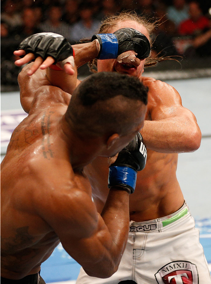 BOSTON, MA - AUGUST 17:  (L-R) Iuri Alcantara punches Urijah Faber in their UFC bantamweight bout at TD Garden on August 17, 2013 in Boston, Massachusetts. (Photo by Josh Hedges/Zuffa LLC/Zuffa LLC via Getty Images)