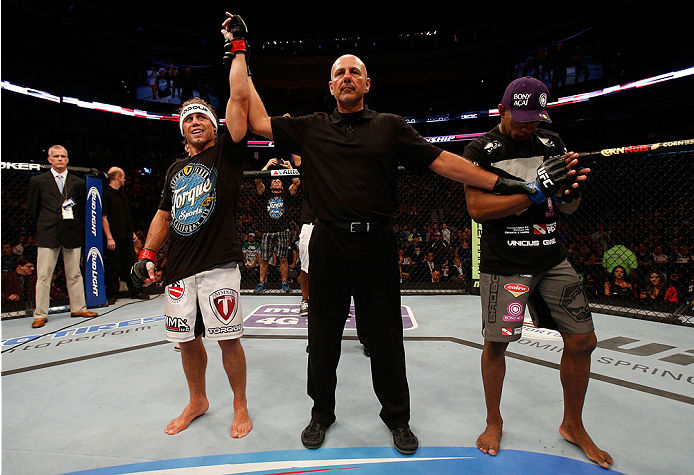 BOSTON, MA - AUGUST 17:  Urijah Faber (L) reacts after his victory over Iuri Alcantara in their UFC bantamweight bout at TD Garden on August 17, 2013 in Boston, Massachusetts. (Photo by Josh Hedges/Zuffa LLC/Zuffa LLC via Getty Images)