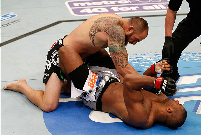 BOSTON, MA - AUGUST 17:  (L-R) Travis Browne knocks out Alistair Overeem with a series of punches in their UFC heavyweight bout at TD Garden on August 17, 2013 in Boston, Massachusetts. (Photo by Josh Hedges/Zuffa LLC/Zuffa LLC via Getty Images)