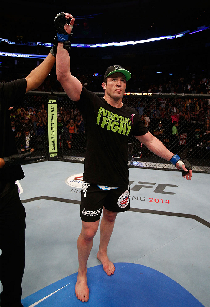 """BOSTON, MA - AUGUST 17:  Chael Sonnen reacts after his submission victory over Mauricio """"Shogun"""" Rua in their UFC light heavyweight bout at TD Garden on August 17, 2013 in Boston, Massachusetts. (Photo by Josh Hedges/Zuffa LLC/Zuffa LLC via Getty Images)"""