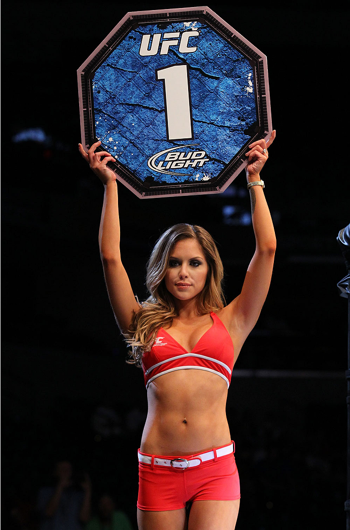 INDIANAPOLIS, IN - AUGUST 28:  UFC Octagon Girl Brittney Palmer introduces a round during the UFC on FOX Sports 1 event at Bankers Life Fieldhouse on August 28, 2013 in Indianapolis, Indiana. (Photo by Ed Mulholland/Zuffa LLC/Zuffa LLC via Getty Images)