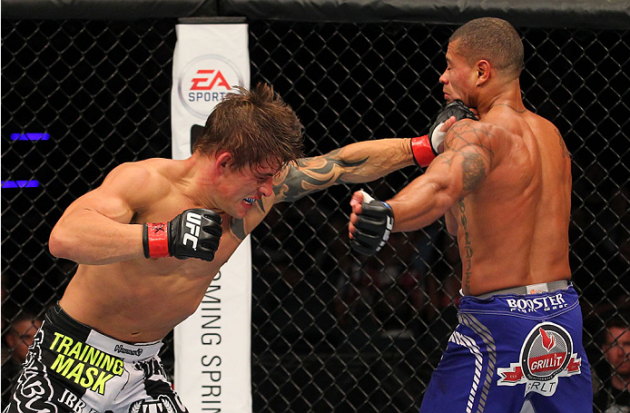 INDIANAPOLIS, IN - AUGUST 28:  (L-R) Roger Bowling punches Abel Trujillo in their lightweight fight during the UFC on FOX Sports 1 event at Bankers Life Fieldhouse on August 28, 2013 in Indianapolis, Indiana. (Photo by Ed Mulholland/Zuffa LLC/Zuffa LLC vi