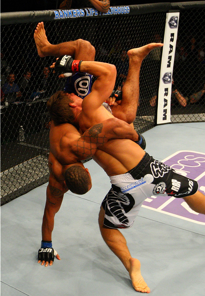 INDIANAPOLIS, IN - AUGUST 28:  (R-L) Roger Bowling takes down Abel Trujillo in their lightweight fight during the UFC on FOX Sports 1 event at Bankers Life Fieldhouse on August 28, 2013 in Indianapolis, Indiana. (Photo by Ed Mulholland/Zuffa LLC/Zuffa LLC
