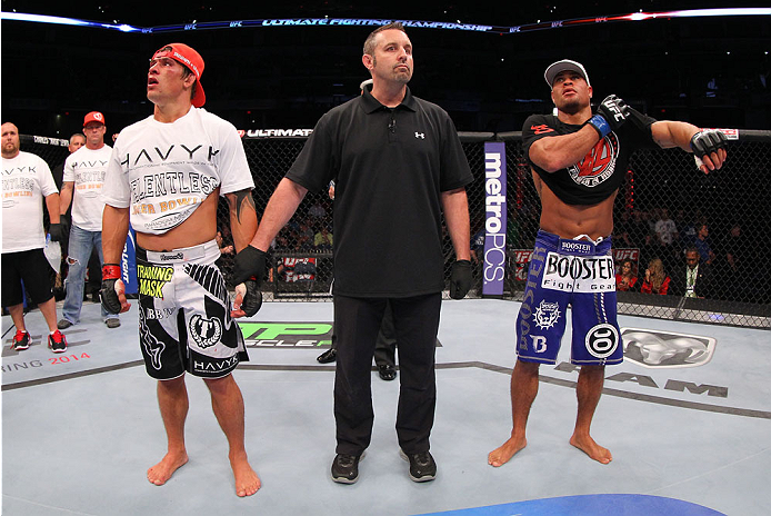 INDIANAPOLIS, IN - AUGUST 28:  Roger Bowling (L) and Abel Trujillo (R) react after their lightweight fight was declared a no-contest during the UFC on FOX Sports 1 event at Bankers Life Fieldhouse on August 28, 2013 in Indianapolis, Indiana. (Photo by Ed