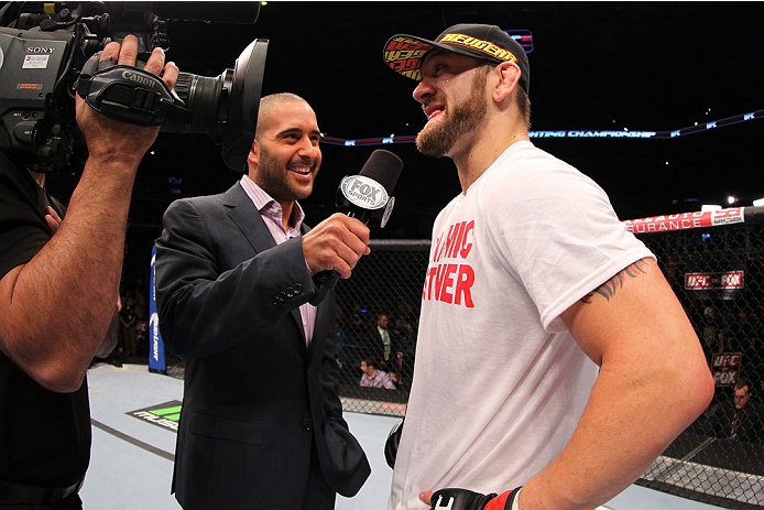 INDIANAPOLIS, IN - AUGUST 28:  (R-L) Zak Cummings is interviewed by Jon Anik after his victory over Benny Alloway in their welterweight fight during the UFC on FOX Sports 1 event at Bankers Life Fieldhouse on August 28, 2013 in Indianapolis, Indiana. (Pho
