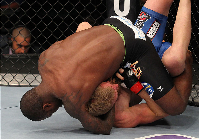 INDIANAPOLIS, IN - AUGUST 28: (L-R) Jason High secures a guillotine choke submission against James Head in their welterweight fight during the UFC on FOX Sports 1 event at Bankers Life Fieldhouse on August 28, 2013 in Indianapolis, Indiana. (Photo by Ed M