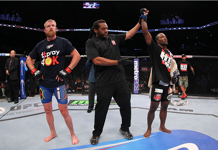 INDIANAPOLIS, IN - AUGUST 28:  Jason High (R) reacts after his submission victory over James Head (L) in their welterweight fight during the UFC on FOX Sports 1 event at Bankers Life Fieldhouse on August 28, 2013 in Indianapolis, Indiana. (Photo by Ed Mul