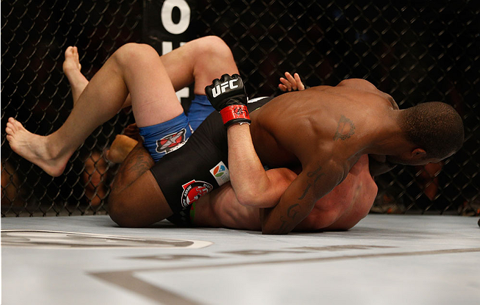 INDIANAPOLIS, IN - AUGUST 28:  (R-L) Jason High secures a guillotine choke submission against James Head in their welterweight fight during the UFC on FOX Sports 1 event at Bankers Life Fieldhouse on August 28, 2013 in Indianapolis, Indiana. (Photo by Jos