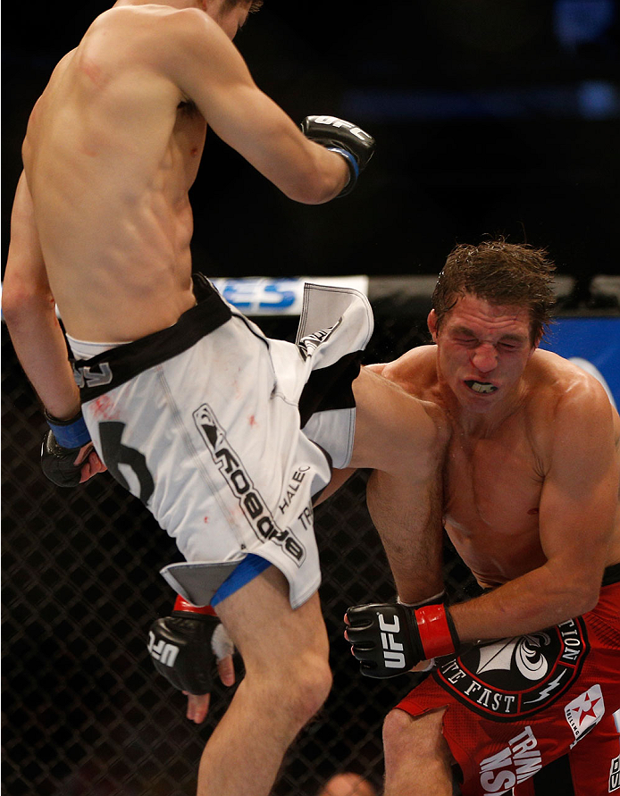 INDIANAPOLIS, IN - AUGUST 28:  (L-R) Hatsu Hioki knees Darren Elkins in their featherweight fight during the UFC on FOX Sports 1 event at Bankers Life Fieldhouse on August 28, 2013 in Indianapolis, Indiana. (Photo by Josh Hedges/Zuffa LLC/Zuffa LLC via Ge
