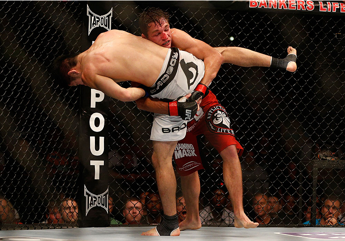 INDIANAPOLIS, IN - AUGUST 28:  (R-L) Darren Elkins takes down Hatsu Hioki in their featherweight fight during the UFC on FOX Sports 1 event at Bankers Life Fieldhouse on August 28, 2013 in Indianapolis, Indiana. (Photo by Josh Hedges/Zuffa LLC/Zuffa LLC v