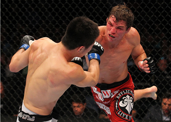 INDIANAPOLIS, IN - AUGUST 28:  (R-L) Darren Elkins punches Hatsu Hioki in their featherweight fight during the UFC on FOX Sports 1 event at Bankers Life Fieldhouse on August 28, 2013 in Indianapolis, Indiana. (Photo by Ed Mulholland/Zuffa LLC/Zuffa LLC vi