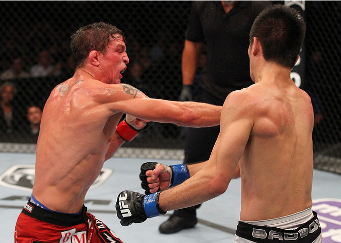 INDIANAPOLIS, IN - AUGUST 28:  (L-R) Darren Elkins punches Hatsu Hioki in their featherweight fight during the UFC on FOX Sports 1 event at Bankers Life Fieldhouse on August 28, 2013 in Indianapolis, Indiana. (Photo by Ed Mulholland/Zuffa LLC/Zuffa LLC vi