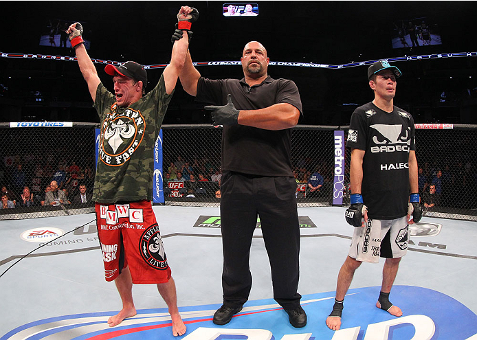 INDIANAPOLIS, IN - AUGUST 28:  Darren Elkins (L) reacts after his victory over Hatsu Hioki (R) in their featherweight fight during the UFC on FOX Sports 1 event at Bankers Life Fieldhouse on August 28, 2013 in Indianapolis, Indiana. (Photo by Ed Mulhollan