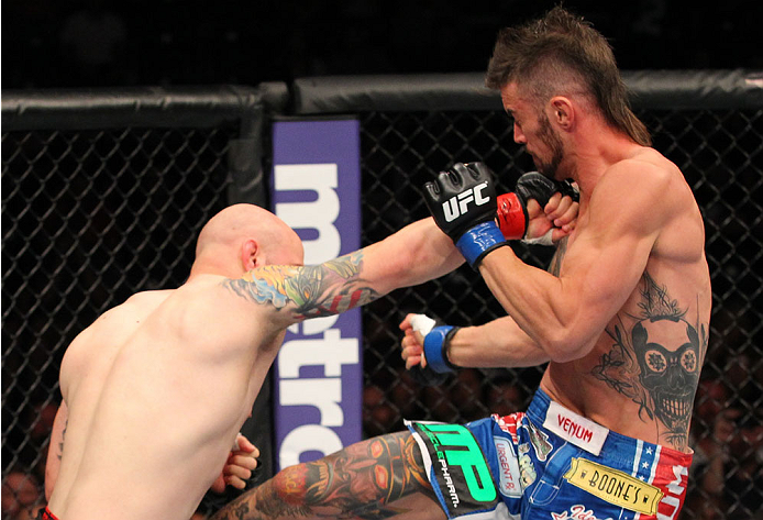 INDIANAPOLIS, IN - AUGUST 28:  (L-R) Justin Edwards punches Brandon Thatch in their welterweight fight during the UFC on FOX Sports 1 event at Bankers Life Fieldhouse on August 28, 2013 in Indianapolis, Indiana. (Photo by Ed Mulholland/Zuffa LLC/Zuffa LLC